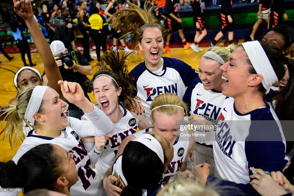 The Pennsylvania Quakers women's basketball team celebrates their win over the Princeton Tigers in the Ivy League tournament final at The Palestra on March 12, 2017 in Philadelphia, Pennsylvania. Penn won 57-48.