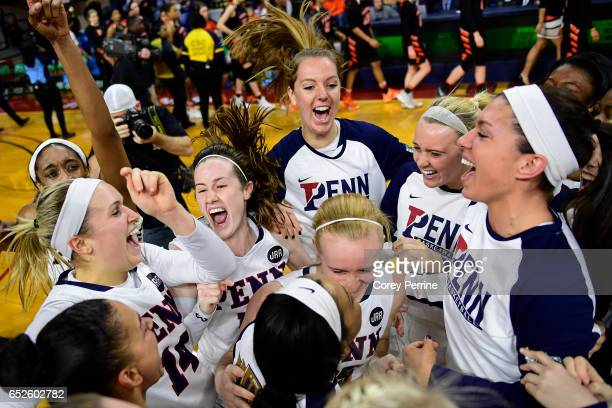 The Pennsylvania Quakers women's basketball team celebrates their win over the Princeton Tigers in the Ivy League tournament final at The Palestra on...
