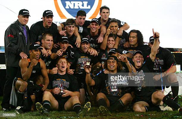 The Penrith Panthers celebrate victory after the NRL Grand Final between the Sydney Roosters and the Penrith Panthers at Telstra Stadium October 5...