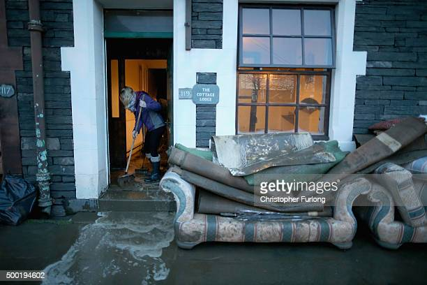 The people of Keswick begin the clean up after flood damage caused by Storm Desmond on December 6 2015 in Keswick England Storm Desmond has brought...