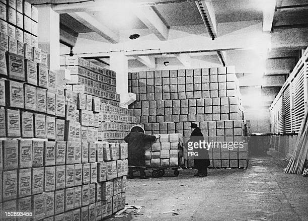 The people of West Berlin prepare for the possibility of a second Berlin Blockade by the Soviet Union by stockpiling food during the Berlin Crisis...