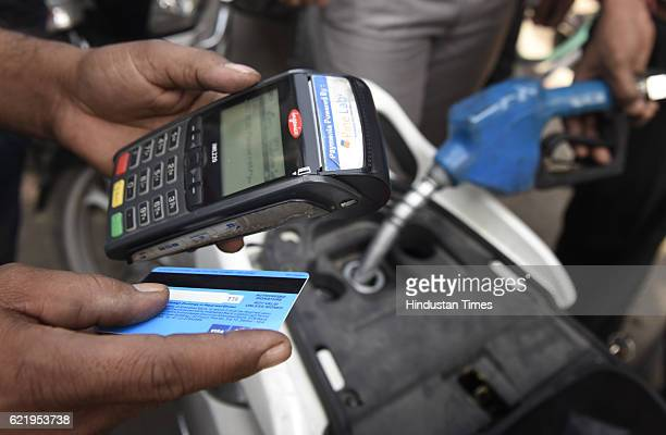 The people using debit card to pay for the petrol at Petrol Pump in Mayur Vihar on November 9 2016 in New Delhi India In a surprise announcement late...
