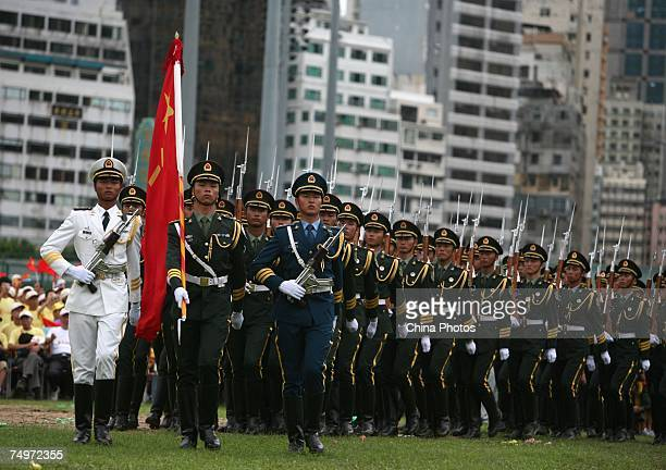 The People's Liberation Army guard of honour march to attend a flag raising ceremony at the Happy Valley on July 1 2007 in Hong Kong China The former...