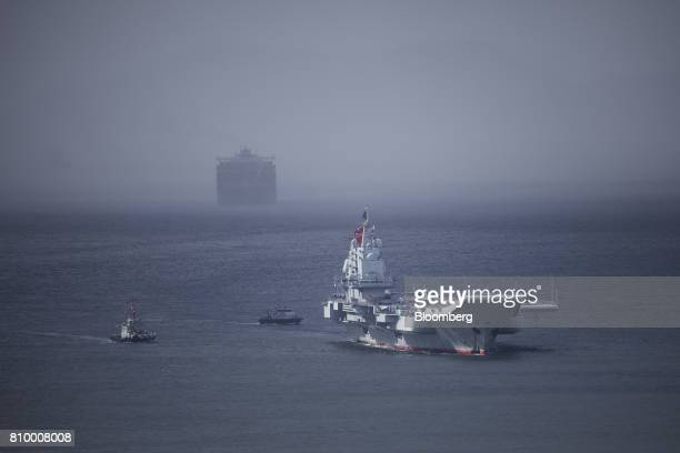 The People's Liberation Army Liaoning aircraft carrier, front, sails into Hong Kong, China, on Friday, July 7, 2017. The carrier will visit Hong Kong...