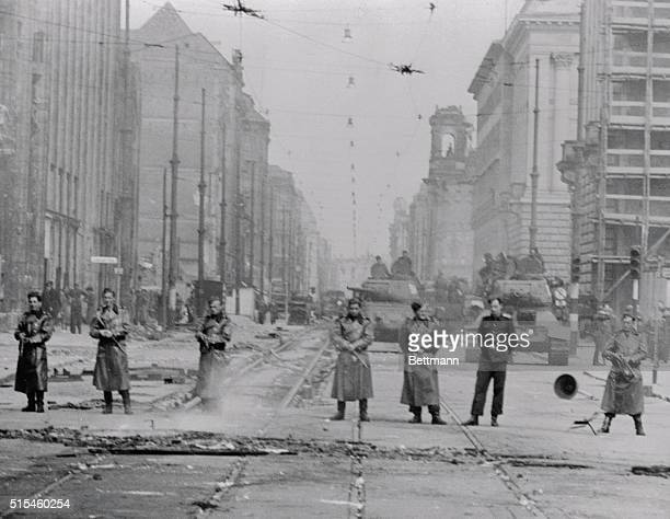 The People's Police and Russian tanks are shown guarding Leipziger Street in East Berlin after Martial Law was declared due to the recent uprisings...