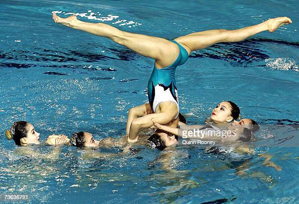 The People's Republic of Korea performs in the Team Free Routine preliminary round at the synchronized swimming event during the XII FINA World...
