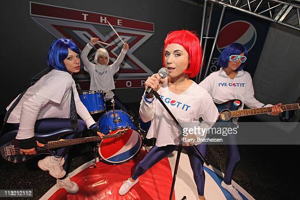 The PEPSI PEP Girls strike a pose in the Pepsi X Factor Photo stage during X Factor and official sponsor Pepsi Take on the Windy City with Chicago...