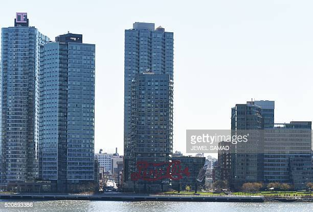 The PepsiCola sign in Long Island City is seen from Midtown Manhattan in New York on April 13 2016 After years on the NYC Landmarks Preservation...