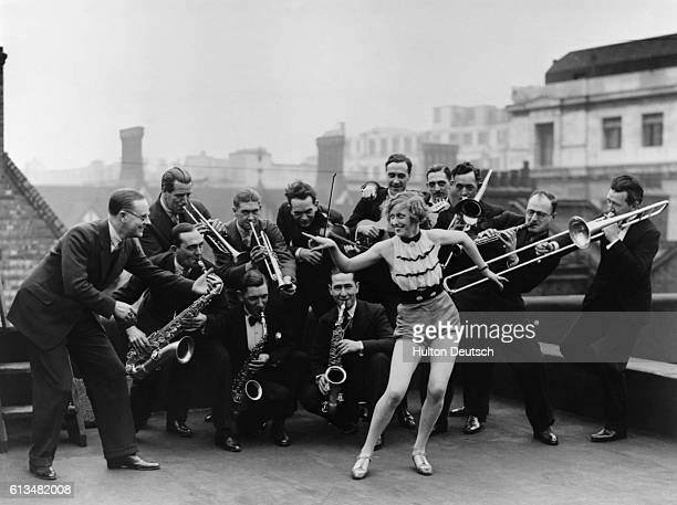 The Percival Mackey Dance Band rehearsing with Monte Ryan on the roof of the Savoy Hotel in London
