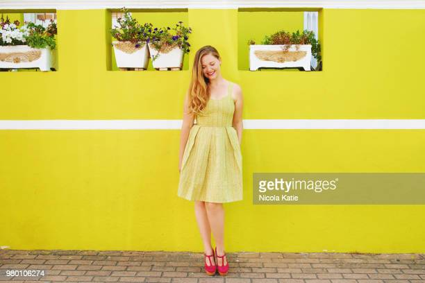 the perfect dress means the perfect day - long bright yellow dress stock pictures, royalty-free photos & images