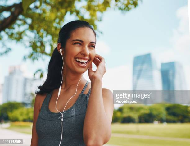 the perfect playlist puts me in the perfect mood - peopleimages stock pictures, royalty-free photos & images