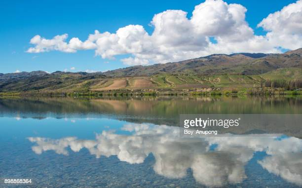 The perfect reflection of lake Dunstan in Otago region of New Zealand.