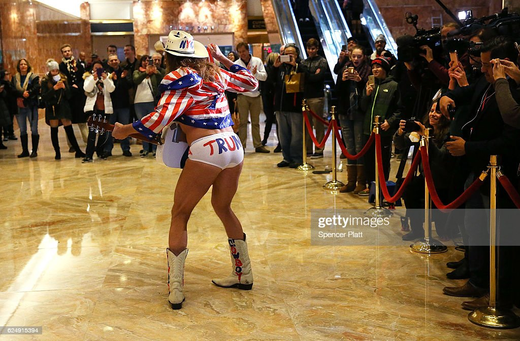 The performer known as the Naked Cowboy performs for members of the media at Trump Tower on November 21, 2016 in New York City. President-elect Donald Trump and his transition team are in the process of filling cabinet and other high level positions for the new administration.