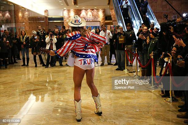 The performer known as the Naked Cowboy performs for members of the media at Trump Tower on November 21 2016 in New York City Presidentelect Donald...