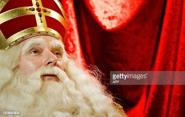 The performer playing Sinterklaas looks on as the Sinterklaas procession arrives in Dordrecht on November 13 2011 AFP PHOTO/ ANP/ KOEN VAN WEEL...