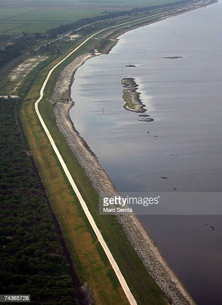 The perimeter road winds around the coast of Lake Okeechobee once did May 31 2007 in Pahokee Florida Lake Okeechobee tied a record an alltime water...