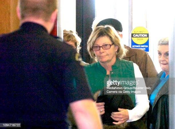 The person believed to be Dottie Shannon moves through security before the first court appearance for Alex Pacheco who is being held on murder...