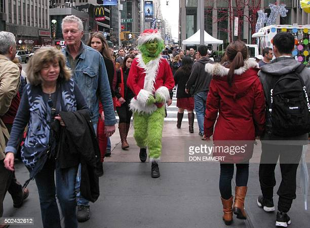 The person dressed as the Grinch Who Stole Christmas walks up Sixth Ave on December 24 2015 in New York According to the National Weather Service...