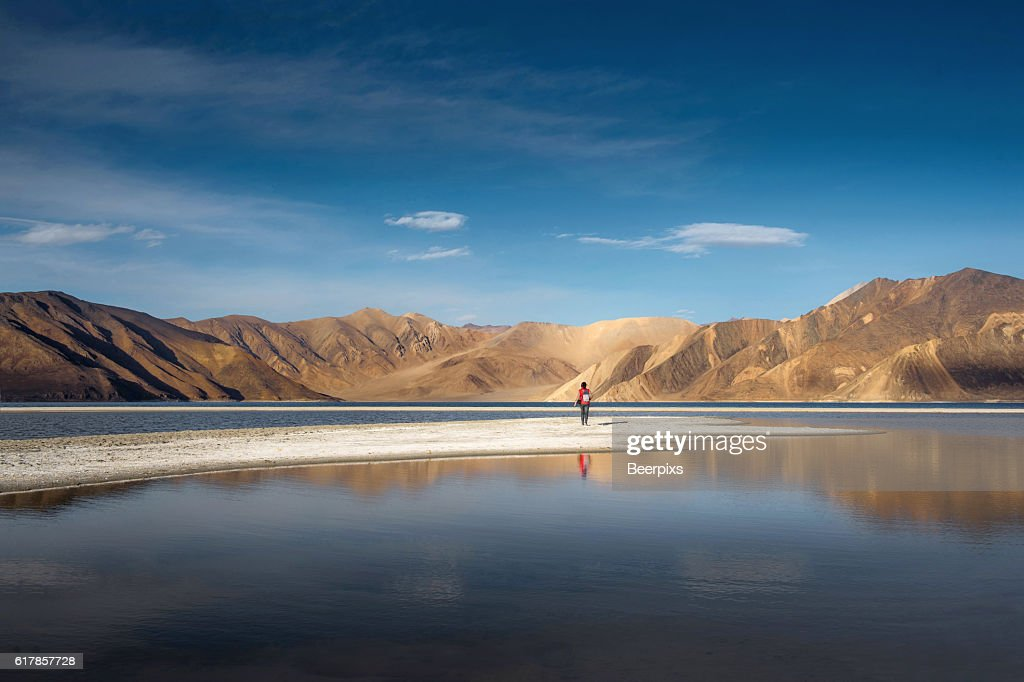 The person look at mountains in Pangong Lake and blue sky, Leh Ladakh. : Stock Photo