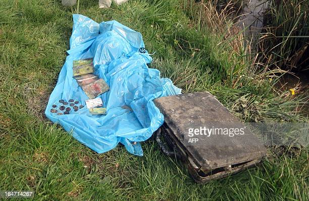 The personal belongings found by French gendarmes in a car recovered from the Sevre river inside which a skeleton was found are pictured on March 26...
