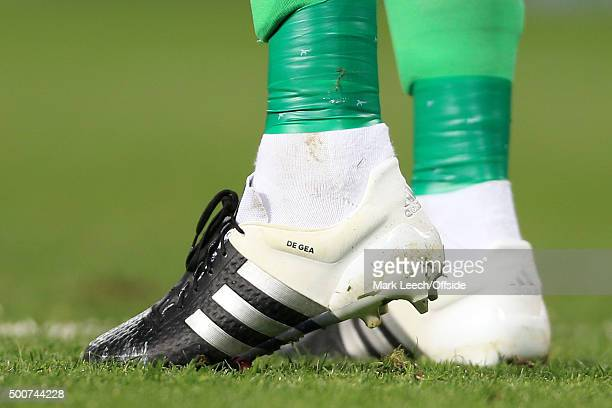 The personalised white Adidas boots of Man Utd goalkeeper David De Gea are seen during the Barclays Premier League match between Manchester United...