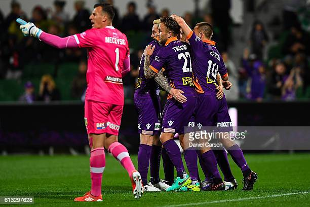 The Perth Glory celebrate the goal scored by Diego Castro during the round one ALeague match between the Perth Glory and the Central Coast Mariners...