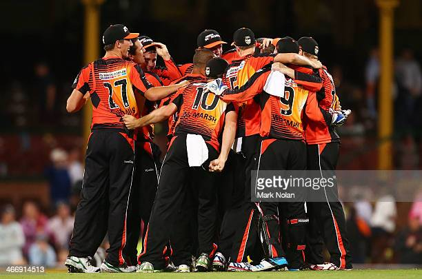 The Perth Scorchers celebrate victory during the Big Bash League semi final match between the Sydney Sixers and the Perth Scorchers at Sydney Cricket...
