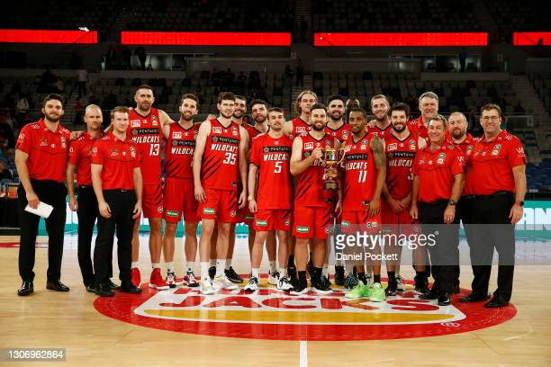 The Perth Wildcats pose for a photograph after being presented with the NBL Cup, after their against the Adelaide 36ers at John Cain Arena on March...