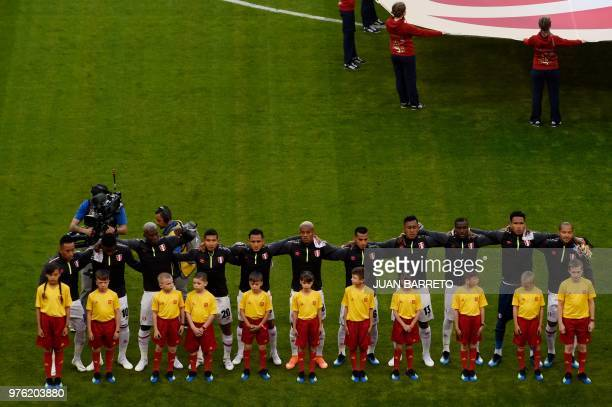 The Peru team lines up for the national anthems ahead of kick off of the Russia 2018 World Cup Group C football match between Peru and Denmark at the...