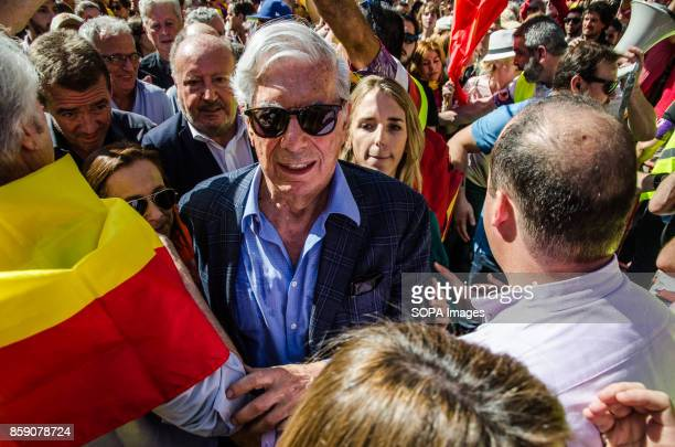 The Peruvian writer Vargas Llosa reaches the stage area to participate in the reading of proclamations Massive demonstration in Barcelona in defense...
