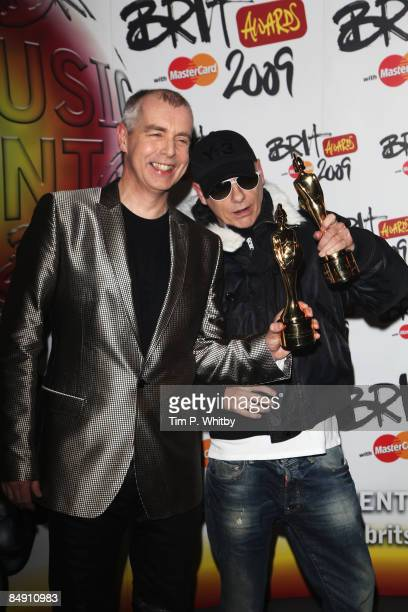 The Pet Shop Boy Neil Tennant and Chris Lowe pose backstage with the Oustanding Contribution to Music at the Brit Awards 2009 at Earls Court on...