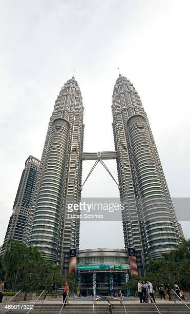 The Petronas Towers stand on March 28 2009 in Kuala Lumpur Malaysia The Petronas Twin Towers are the tallest twin buildings in the world Designed by...