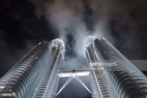 The Petronas Twin Towers are seen at night in Kuala Lumpur November 20 2015 The Malaysian city hosts the 27th Association of South East Asian Nations...