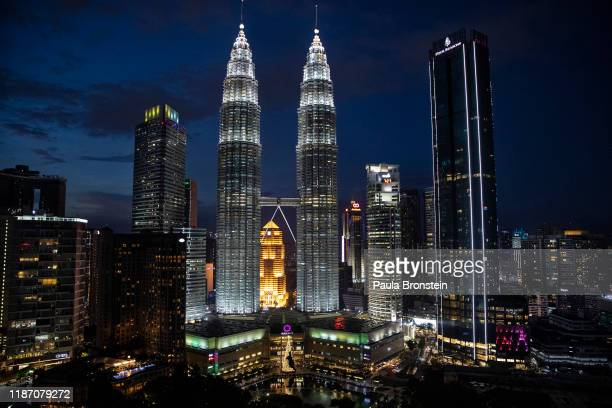 The Petronas Twin Towers are seen in the skyline at the peak of the Christmas holiday season in Kuala Lumpur, Malaysia on December 6, 2019. Shopping...