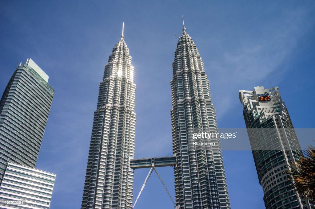 The Petronas Twin Towers (KLCC), center, stand in Kuala Lumpur, Malaysia, on Thursday, April 25, 2013. Malaysians will go to the polls on May 5. Prime Minister Najib Razak's National Front coalition is seeking to extend its 55 years of unbroken rule in the face of a resurgent opposition led by Anwar Ibrahim. Photographer: Sanjit Das/Bloomberg via Getty Images
