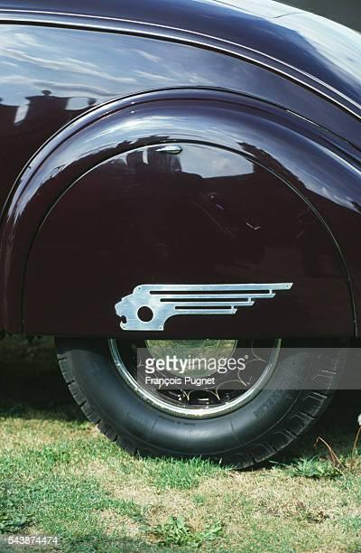 The Peugeot 402 Roadster emblem