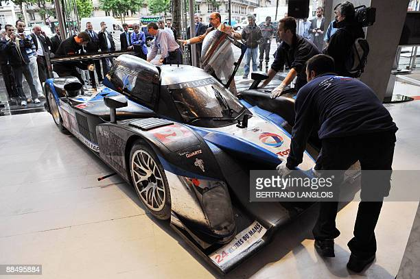 The Peugeot 908 HDiFAP car of the winners of the Le Mans 24 hour race teammates Alexander Wurtz of Austria Marc Gene of Spain and Australian David...