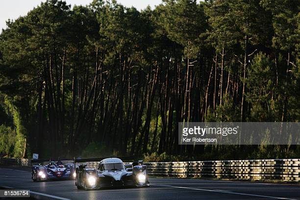 The Peugeot 908 of Christian Klien of Austria Franck Montagny of France and Ricardo Zonta of Brazil drives down the Mulsanne Straight during...