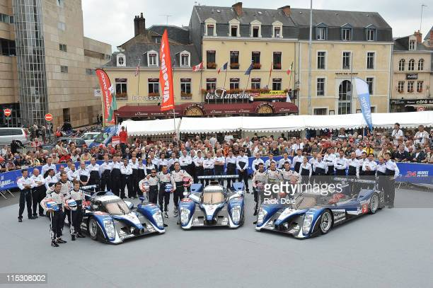 The Peugeot Sport team photo of the Peugeot 908 of Marc Gene of Spain, Alexander Wurz of Austria, and Anthony Davidson of England; the Peugeot 908 of...