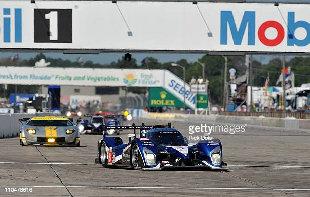 The Peugeot Sport Total Peugeot 908 driven by Stephane Sarrazin of France, Franck Montagny of France, and Pedro Lamy of Portugal during the...