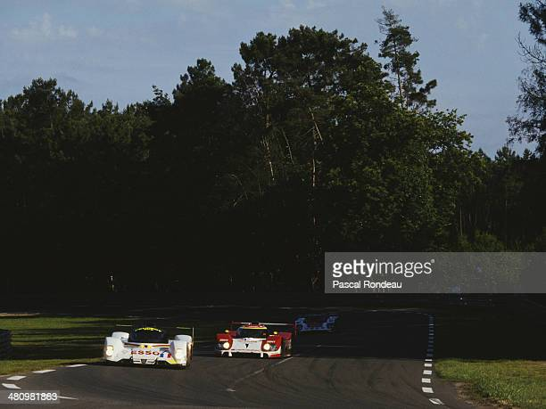 The PeugeotTalbot Sport Peugeot 905 Evo 1 Bis LM driven by Thierry Boutsen Yannick Dalmas and Teo Fabi ahead of the Toyota Team Tom's Toyota TS010...