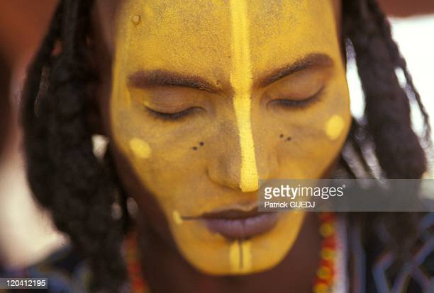 The Peul Bororo Geerewol festival in Niger in 1998 Young man preparing for the ceremony The annual festival of traditional Geerewol is practiced only...