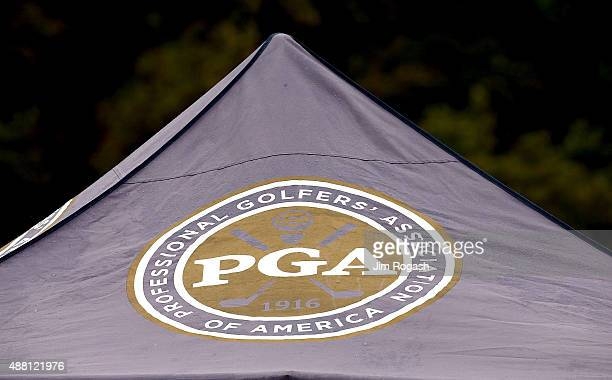 The PGA logo covers the top of a tent during the Drive, Chip, and Putt Championship at The Country Club on September 13, 2015 in Brookline,...