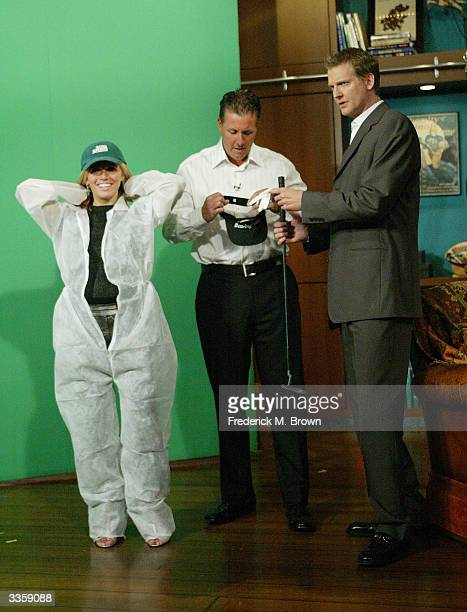 The PGA's The Masters champion Phil Mickelson Amy Mickelson and host Craig Kilborn recreate a press photo during a taping of 'The Late Late Show With...