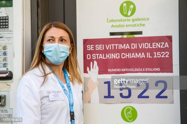 The pharmacist Alessia from the Coni Zugna Pharmacy poses during the first day of phase two of the containment of the pandemic from Covid19 on May 04...