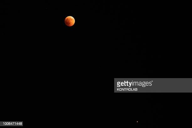 The phase of total eclipse of the moon which turns red The lunar eclipse is considered the longest eclipse of the century as it lasts 103 minutes and...