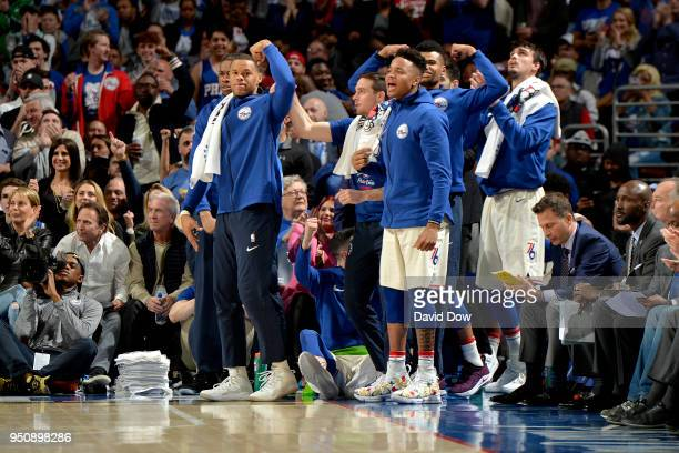 The Philadelphia 76ers bench celebrates during the game against the Miami Heat in Game Five of Round One of the 2018 NBA Playoffs on April 24 2018 at...