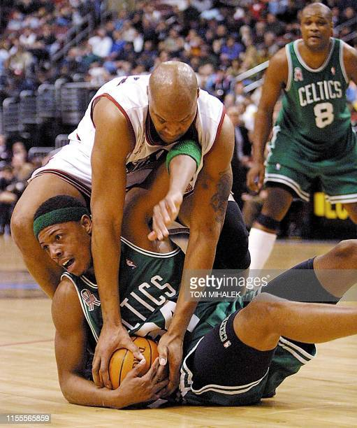 The Philadelphia 76ers' Derrick Coleman and the Boston Celtics' Paul Pierce fight for the ball near the Celtic's basket in the 1st period of their...