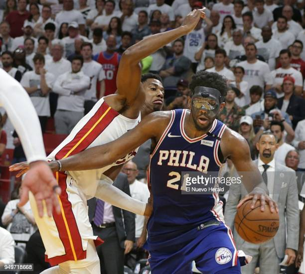 The Philadelphia 76ers' Joel Embiid drives against the Miami Heat's Hassan Whiteside in the fourth quarter in Game 4 of the firstround NBA Playoff...