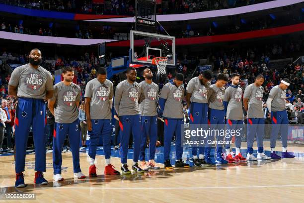 The Philadelphia 76ers stands for the National Anthem before the game against the Detroit Pistons on March 11, 2020 at the Wells Fargo Center in...